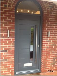 contemporary door arched frame Arched Front Door, Grey Front Doors, Modern Front Door, Front Door Entrance, House Front Door, Glass Front Door, House With Porch, Sliding Glass Door, Front Hallway