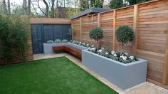 Topiary grey walls fake grass fence London formal Fulham Chelsea Wandsworth Dulwich modern design