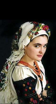 Eastern Europe | Portrait of a woman wearing traditional clothes and headscarf, Ukraine