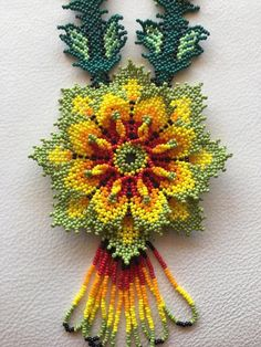Beautiful Huichol Beaded Flower Necklace Brand New Never Worn. Dispatched with Royal Mail Signed For® Class Letter. Diy Necklace Patterns, Beaded Jewelry Patterns, Beading Patterns, Bead Embroidery Jewelry, Beaded Embroidery, Embroidery Bracelets, Seed Bead Projects, Beaded Bags, Beaded Necklaces
