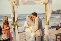 Draped bamboo chuppah with floral accents Beach Wedding Four Seasons Resort Hualalai Weddings