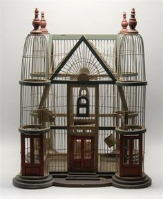 VICTORIAN PAINTED WOOD AND WIRE BIRD CAGE With four tower st