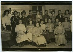 A group of young ladies and men, of varying ages, pose together with basket making materials, circa 1900.   CONTENTdm link:  http://libcdm1.uncg.edu/cdm/ref/collection/ttt/id/34380/rec/2