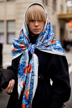 a wool scarf like from here http://www.rusclothing.com/russian-shawls/dense-wool/ and a plain black coat.