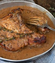 Pork Chops with Peppercorn Sauce - These delicious, thick Pork Chops with Peppercorn Sauce are one of my favourite ways to enjoy a pork chop dinner. Smoked Meat Recipes, Meat Recipes For Dinner, Pork Chop Recipes, Food Network Recipes, Cooking Recipes, Healthy Recipes, Healthy Meals, Butterflied Pork Chops, Pork Chop Dinner