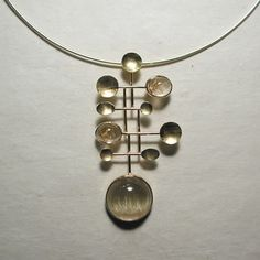 Google Image Result for http://www.sarantos.com/assets/images/jewelry_designs/precious/rutilated_quartz_necklace_03.jpg