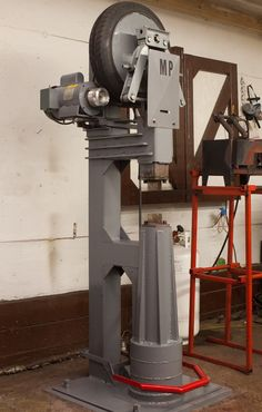 Power Hammer by 556mp -- Homemade power hammer constructed from tubing, steel plate, bar stock, bearings, shafting, a tire, and an electric motor. http://www.homemadetools.net/homemade-power-hammer-18