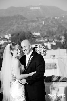 Melissa and Scott pose with the Hollywood Hills and its iconic Hollywood sign as their backdrop at the Hollywood Roosevelt Hotel
