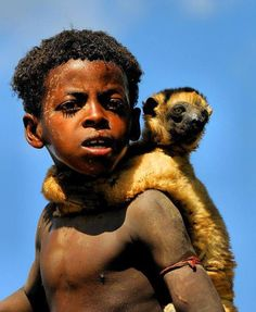 Boy with Lemur, Madagascar © Andrea Scabini