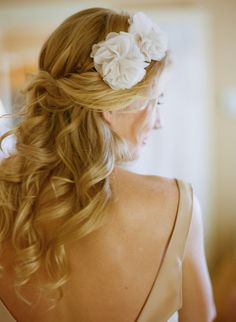 Pulled back with white flower hair pin. Courtesy of Jessica Lorren Organic Photography via Ruffled.