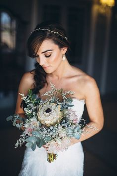 This protea centered bridal bouquet is absolute perfection! Image by Kikitography