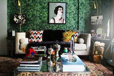 Bold Piero Fornasetti wallpaper sets the tone in jewelry design Alexis Zambrano's Manhattan apartment.   - ELLEDecor.com