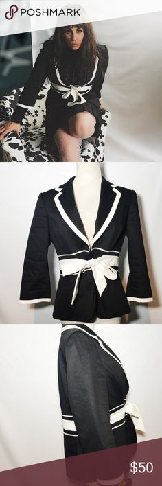 "TAHARI BLACK AND WHITE BLAZER JACKET 8 P MEDIUM Waist length with 3/4 sleeves. Black with white bordered cuffs and collar. Hidden clasp front closure. Thick white bow that ties front. Size 8p (medium) Approx measurements ""25 length, 15"" arm,  16"" shoulder Good condition. Retail $145 Tahari Jackets & Coats Blazers"