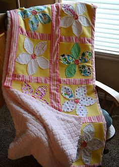 Flower quilt made from the outfits my daughter wore during her first year.