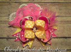 Female Monkey Pink and yellow bow with Marabou feathers and Lace on alligator clip on Etsy, $6.50