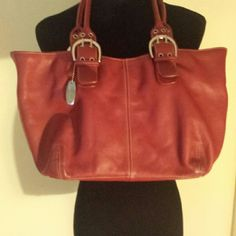Gently used Tignanello Deep Red Tote Silver hardware. Magnetic close.  Large.   Exceptional quality. Tignanello Bags Totes