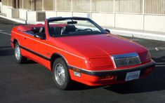 1989 Chrysler LeBaron convertible *** I wrecked it in an accident with a drunk driver in 1990. My parents' car.