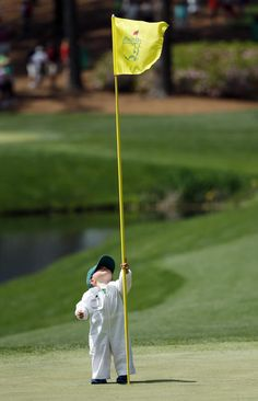 2014 Masters - Golfers' children work as adorable caddies