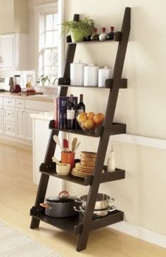 Different way to use ladder bookshelf - in the kitchen to store pots, bowls, cookbooks and more