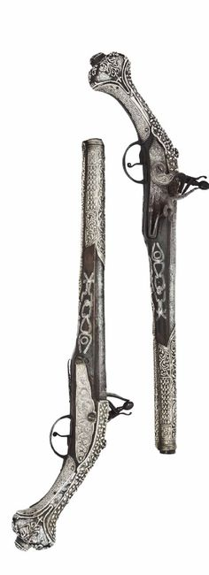 A PAIR OF OTTOMAN 16-BORE SILVER-MOUNTED FLINTLOCK HOLSTER PISTOLS   EARLY 19TH CENTURY