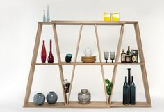 The Bookshelf is a modern, fold-up shelf designed by Laurindo Marta for WeWood out of solid oak that you can customize to your liking. Modular Bookshelves, Modular Shelving, Modular Storage, Shelving Systems, Bookcase Shelves, Wall Mounted Shelves, Bookcases, Shelving Design, Shelf Design