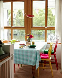 Home Tour: Colourful London Houseboat.  Love that each chair is a different color.
