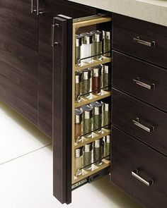 スパイスラック 収納 Finding it tough to keep your spices in order? Install an ingenious space-saving pullout rack that fits comfortably between cabinets and drawers. Spice Rack Plans, Pull Out Spice Rack, Spice Racks, Spice Storage, Storage Rack, Kitchen Organization, Kitchen Storage, Storage Organization, Storage Ideas