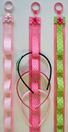 DIY Headband Holder. The hanger is crafted using high quality grosgrain ribbon and has 7 large loops for hanging headbands on. The hanger will hold at least 14 headbands.