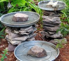 "Stone leftover from another project and three galvanized trash can lids become a bird bath grouping! Another of my ""use what you have"" ventures! More pictures and directions at http://ourfairfieldhomeandgarden.com"