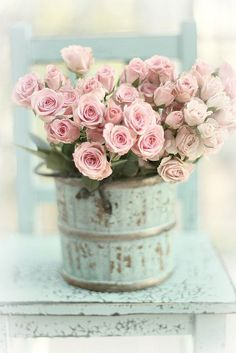 Pretty pink roses in shabby chic container. Cute centerpiece for tea party.