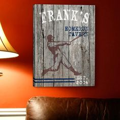 Give your No. 1 man and favorite baseball fan this unique, personalized homerun canvas print. Fashioned with a weathered wood-look background, the sign showcases an old-fashioned image of a slugger in mid swing. Ideal for any occasion, this gallery wrapped canvas sign comes ready to hang and will make a statement wherever it is displayed. No strike outs with this gift Personalize with name up to 15 characters at the top of the sign, up to 30 characters open text of your choice below name be…