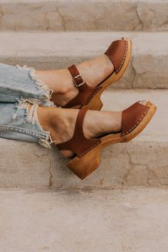 These peep toe heels are thee perfect shoe for everyday wear. Featuring peep-toe front, adjustable ankle strap, and low platform, this shoe is both comfortable and stylish. Clogs Outfit, Clogs Shoes, Shoe Boots, Clog Sandals, Slingback Sandal, Heeled Sandals, Boho Shoes, Women's Casual Shoes, Hippie Shoes