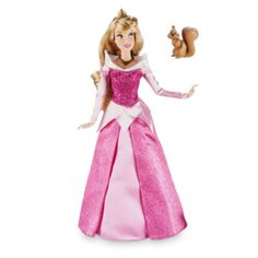 With her golden hair flowing loose, our Aurora classic doll will enchant little ones! Along with her squirrel friend, the Sleeping Beauty princess wears her signature pink dress, with glittering details.