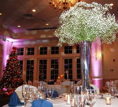 Baby's breath in silver mercury pilsner vases at the Forsgate Country Club. Designed and Owned by Monday Morning Flower and Balloon Co