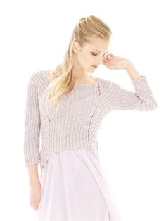 Knit this womens ribbed sweater from Rowan Knitting & Crochet Magazine 53, a design by Sarah Hatton using the gorgeous yarn Panama (viscose, cotton and linen). With a square neckline, bell shaped sides and ¾ length set-in sleeves, this knitting pattern is for the experienced knitter.