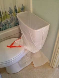 How to paint behind your toilet tank: 1. Remove lid. 2. Take a drawstring kitchen garbage bag and place over tank. 3. Cut in front if needed for tight fit. 4. Draw drawstring to front to tighten bag in the back. 5. Place paper towels on floor to catch any drips. 6. Carefully paint with brush or extended reach painting tools. 7. When finished, put any used/wet paper towels on top of bag on open tank. 8. Grab bag at base of tank. Pull inside out as you remove. 9. All trash is in bag. Throw…