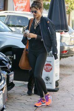 Alessandra Ambrosio wearing Hermes Soleil Evelyne PM Shoulder Bag, Unravel Destroyed Bomber Jacket in Black, Victoria's Secret Fashion Show Zip Hoodie and Victoria's Secret Knockout by Victoria Sport Tights