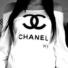 Love this long sleeved off the shoulder Chanel shirt.