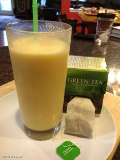 Get a jolt of AM energy with this GREEN TEA SMOOTHIE! Brew one green tea bag in 4 oz hot water for 3-5 minutes; remove tea bag and let tea cool to room temp. Blend the tea, 1/2 cup nonfat vanilla yogurt, 1 cup frozen mango chunks & 3-5 ice cubes until smooth..