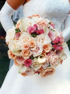 Peach, pink and ivory bridal bouquet.  Flowers of Charlotte loves this!  Find us at www.charlotteweddingflorist.com