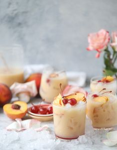 Iced peach colada mocktails that mix peach juice with pineapple juice and coconut milk over crushed iced, all topped with maraschino cherries! Refreshing Drinks, Summer Drinks, Fun Drinks, Juice Drinks, Beverages, Peach Drinks, Peach Alcohol Drinks, Peach Juice, Pineapple Juice