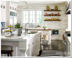 double islands.  Love the butcher block and the marble