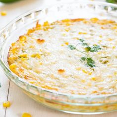 Hot Cheesy Corn Dip - Two kinds of cheese, corn and green chiles make for an irresistible dip! Easy comfort food that'll be devoured!
