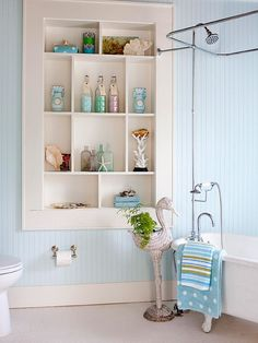 The colour in this bathroom is so pretty over the board and batten. Consider a colour like PPG Pittsburgh Paints Bathing Beauty 253-2 (available at Central) for this airy, refreshing, pretty ambiance. The built-in shelving is a lovely touch also! Practical yet beautiful; just what a room should be! #bathroom #blue