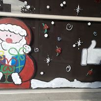 Spreading holiday cheer! #windowpainting #storefronts #business #santaClause #hotwings #Glendale