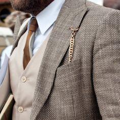 Hmmmmm...Woman's jacket......lapel button hole.....JEWELRY leading to pocket!