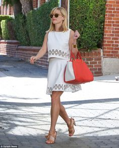 91c5c060cf01 Celebrity Street Style Picture Description Reese Witherspoon heads to her  office in a gorgeous white two-piece and nude sandals