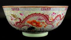 """Chinese 19th C /20th C GuangXu Famille Rose Bowl. The exterior magnificently detailed with a Dragon and Phoenix surrounded by scrolling foliage and floral blossoms amid leafy tendrils formed Ruyi on foot. All reserved on a bright green ground with 6 Blue Characters on Base, GuangXu Reign mark Measuring 6.5"""" dia x 2.75""""H"""