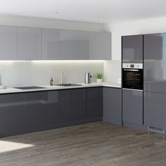 Discover the new handleless cabinets from Howdens. Create an on-trend linear design. Pre-cut to save time on installation. Available from local stock. Grey Gloss Kitchen, Gloss Kitchen Cabinets, Modern Grey Kitchen, Grey Kitchen Designs, Gray And White Kitchen, Kitchen Units, Kitchen Ideas, Kitchen Modular, Kitchen Inspiration