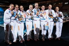 Gold medal winners Russia celebrate after the Synchronized Swimming Team Free Final on day seven of the 15th FINA World Championships at Palau Sant Jordi on July 26, 2013 in Barcelona, Spain.